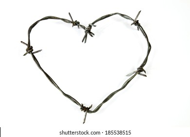 Wire bent in the shape of a heart on a white background