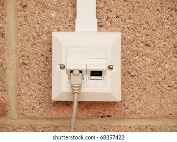 A wire in an ethernet socket for two devices on a building wall