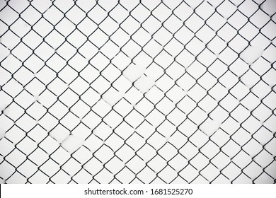wire fence on white snow background