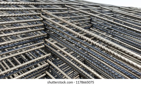 Wire mesh steel used for reinforcing concrete in construction site.