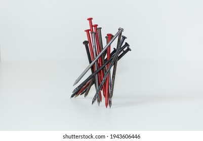 wire metal nails, clouts, nuts on a white background colorful red, rusty, silver gray and black color, iron,  digital print, frame