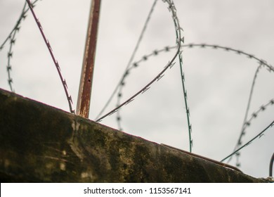 Wire on the wall of the prison.