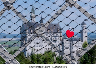 Wireframe with a heart-shaped lock, and in the background Neuschwanstein Castle, in Germany