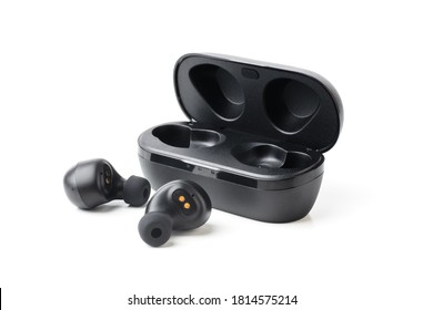 Wireless black bluetooth earphones with contactless charging isolated close-up on a white background