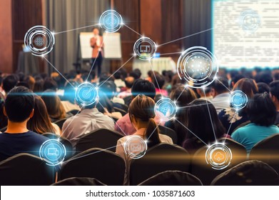 Wireless communication connecting of smart city Internet of Things Technology which driving by Brain icon over Abstract blur photo of conference hall or seminar room,technology and education concept