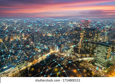 Wireless communication network in Big city in Asia concept. Abstract connection network  on Japan financial district background