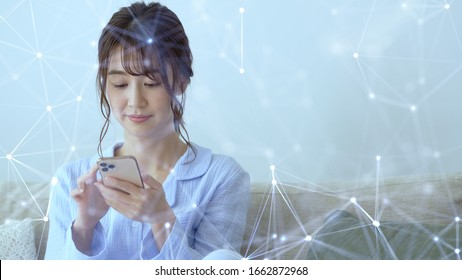 Wireless communication network concept. Mobile technology. Young asian woman using a smart phone.