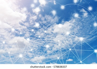 Wireless communication network, IoT Internet of Things and ICT Information Communication Technology concept. Blue sky with cloud in sunny day. Connection background.