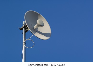 Wireless dish and deep blue sky.