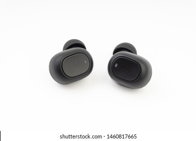 Wireless earbuds or earphones on white background