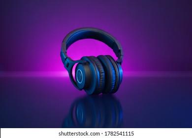 Wireless Gamer Headphones Dark Background and Neon Light.