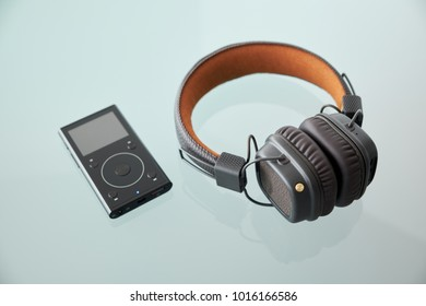 Wireless headphones on glass table