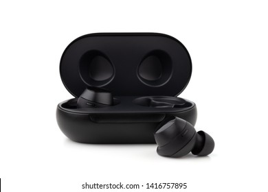 Wireless headphones on a white background. Headset close up in the charging case close-up.