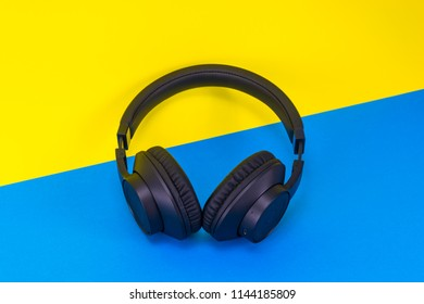 Wireless headphones in a yellow and blue background
