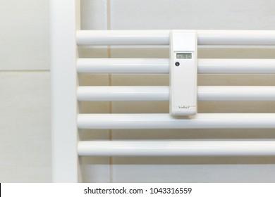 Wireless heat meter mounted on a white radiator.