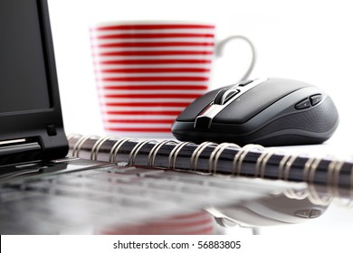 wireless mouse and laptop on desk - office life