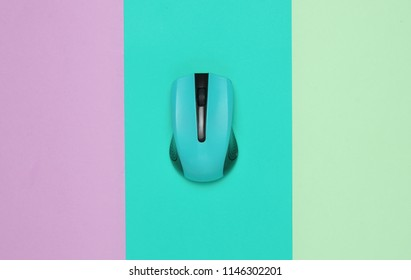 Wireless mouse pc on a multi-colored paper background, minimalism, top view