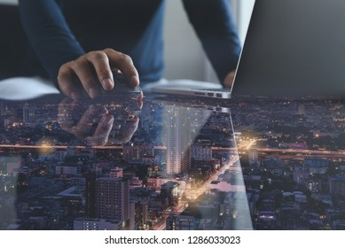 Wireless network communication, 4.0 digital technology development concept. Double exposure of man using wireless mouse and laptop computer with smart city with reflection on desk