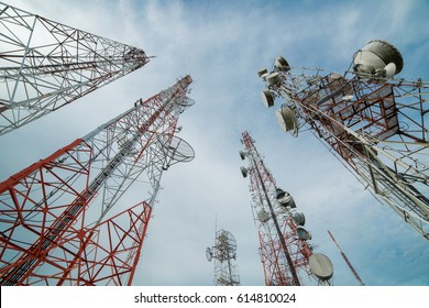 Wireless telecommunications technology with blue sky.