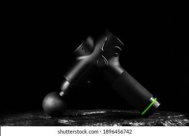 Wireless vibration massager for body on black background