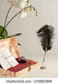 wiriting set with a black quill pen