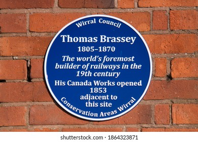 Wirral, UK - Nov 22 2020: A commemorative blue plaque marking the location of the Canada Works site in Birkenhead, Wirral, UK, of the prolific civil engineering contractor Thomas Brassey (1805-1870)