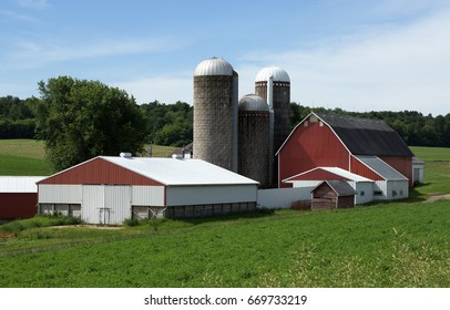 A Wisconsin dairy farm with barn and outbuildings and three silos.