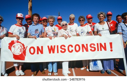 WISCONSIN - MADISON - CIRCA 1990's: Senior Citizens holding `On Wisconsin!` banner in Madison, WI