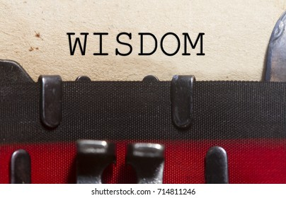Wisdom wise intellect concept- typed on an old vintage paper with od typewriter font.