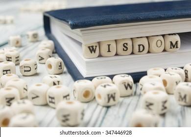 Wisdom word written on wood block