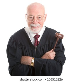 Wise, kind looking judge holding his gavel.  Isolated on white background.