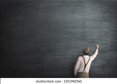 wise man start writing on a empty blackboard