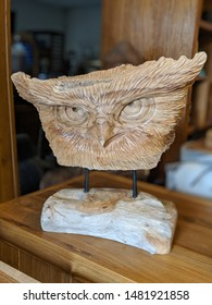 Wise old owl carved out of wood