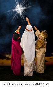 Wisemen played by three girls in a live Christmas nativity scene