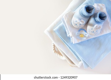 Wish list or shopping overview for pregnancy and baby shower. View from above. White wooden older board