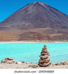 Wish pyramid by the Laguna Verde (Green Lagoon) and Licancabur volcano, Uyuni, Bolivia.