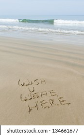 Wish you were here written in sand, Thailand on the Andaman sea coastline