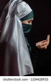 wishes from the heart. friday pray. say a Mohammedan prayer.Islamic devotee performing her namaz