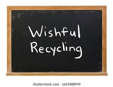 Wishful Recycling written in white chalk on a black chalkboard isolated on white