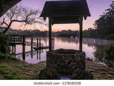 Wishing well overlooking Kerikeri Inlet with morning mist over water. Photographed at dawn at Kororipo Pa, Far North District, Northland, North Island, New Zealand, NZ