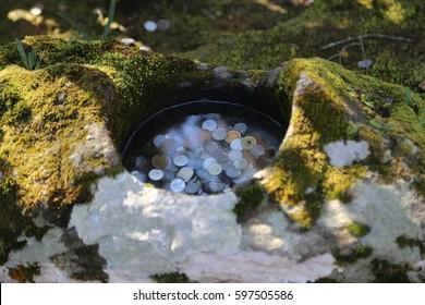 Wishing well in a rock
