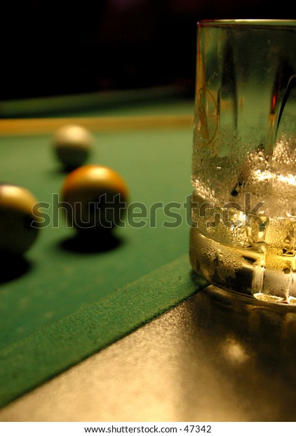 Wiskey on a pool Table