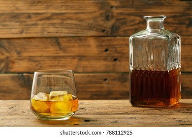 a wiskey or wisky glass on rustic background