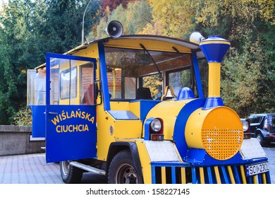 WISLA, POLAND - OCTOBER 13: A road train in Wisla, Poland on October 12, 2013. Train is waiting for passengers while visiting some tourist attraction.