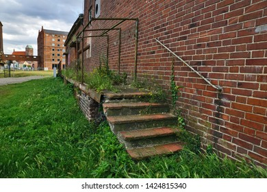 Wismar, East Germany, July 2015: Abandoned and overgrown steps from old VEB terrain lost places