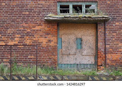 Wismar, East Germany, July 2015:  Abandoned and overgrown gate at old VEB terrain