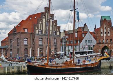 Wismar, East Germany, July 2015: old Harbor view of Wismar