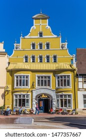 WISMAR, GERMANY - APRIL 19, 2019: Colorful yellow house at the market square of Wismar, Germany
