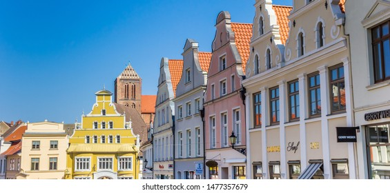 WISMAR, GERMANY - APRIL 19, 2019: Panorama of colorful facades in historic city Wismar, Germany