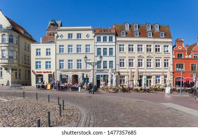 WISMAR, GERMANY - APRIL 19, 2019: Cafes and restaurants at the market square of Wismar, Germany
